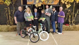 (left to right): Steve Deyo from Jamestown Cycle Shop, Michelle Frederickson from Chautauqua Region Community Foundation, Mayor Sam Teresi, Recreation Coordinator Julia Ciesla-Hanley, Andrew Robinson Jr. from Fessenden, Laumer & DeAngelo; Parks Manager John Williams, Parks Commissioner John Bauer
